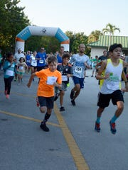 The approximately 235 runners take off. The 4th Annual Marco Island Kiwanis Family 5k was held Saturday morning, starting and ending at Tigertail Beach and running through Hideaway Beach.