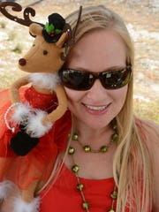 Marissa Fredrickson with Anita the reindeer. The Goodland Civic Association held their Holiday Bazaar Saturday morning at MarGood Harbor Park, with artwork and crafts on sale, live music and food.