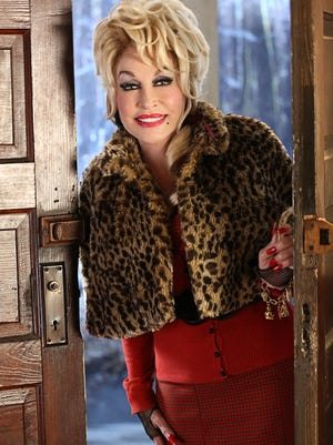 DOLLY PARTON'S CHRISTMAS OF MANY COLORS: CIRCLE OF LOVE -- Season: 1--  Pictured: Dolly Parton as The Painted Lady -- (Photo by: Quantrell Colbert/NBC)