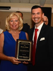 Citizen of the Year Dianna Dohm receives her award