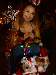 Mariana Ruiz-Vallejo's Mia Sophia and Radar Love, in a lit up buggy, were crowd favorites. The Christmas Island Style Canine Christmas Parade filled the Esplanade with dolled up dogs on Tuesday evening.