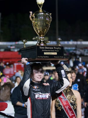 Christian Eckes holds up the champion's trophy after winning the 2016 Snowball Derby at Five Flags Speedway in Pensacola.