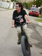 Davis Gross has fat tires and a motorized assist. The Tour de Taverns bicycle poker run Saturday raised funds to help cancer patient Lisa Mayfield, a longtime supporter of the event.