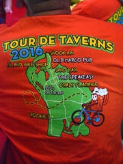 In case riders got lost...The Tour de Taverns bicycle poker run Saturday raised funds to help cancer patient Lisa Mayfield, a longtime supporter of the event.