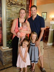 Gino's owners Zac and Mary Simpson with daughters Annella, 4, from right, Lyla, 3, and Jemma, 3 months. Gino's Trattoria, at the corner of Collier Blvd. and Bald Eagle Dr., serves Italian specialties and pizza baked in their new brick oven.
