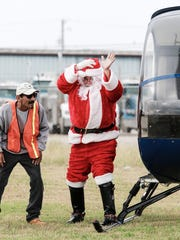Santa arrives via helicopter at Recios Smokehouse & Catering on Saturday, Dec. 24, 2016.