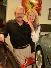 Bill and Karen Young in their garage. Owning 16 collectible - and drivable - cars, plus six classic motorcycles, Marco Islander Bill Young built a house to hold them, with the entire ground floor laid out as a 16-car garage.