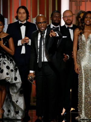 """FSU alum Barry Jenkins ('03) accepts the award for Best Motion Picture - Drama for """"Moonlight,"""" which he wrote and directed, at the 2017 Golden Globes."""