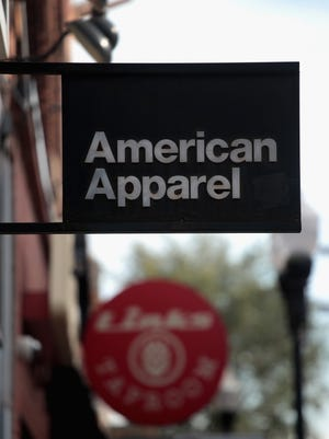 American Apparel is laying off hundreds of employees from its headquarters and a local manufacturing hub.