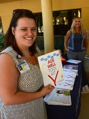 Britney Thoman of NCH offers the 'Age Well' package put together with the Collier County Health Dept. The NCH Marco Healthcare Center hosted an event on Wednesday focusing on how to prevent falls, at their facility on Bald Eagle Drive opposite City Hall.