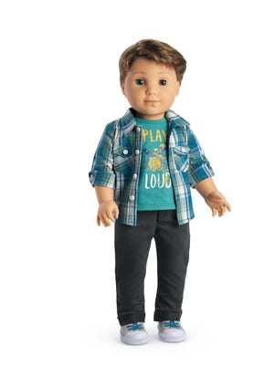 American Girl has introduced its first male doll. Logan Grant will make his debut Thursday as a drummer who accompanies Tenney Grant, a singer who is also making her American Girl debut.