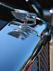 File: Jack Dunning's 2008 Bentley sports a flying B hood ornament at the Kiwanis Club car show.