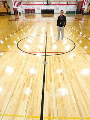 Fond du Lac High School Athletic Director David Michalkiewicz stands on an area of the Fieldhouse floor that was replaced recently due to ongoing problems. About $70,000 in repairs have been made since the Fieldhouse was built in 2000.