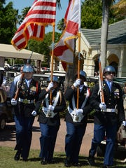 """The Barron Collier High School JROTC honor guard troops the colors. Kensington Golf & Country Club in Naples hosted a golf tournament on March 11, benefiting Home Base programs designed to help heal """"the invisible wounds of war"""" for post-9/11 veterans."""