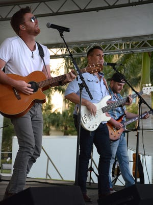 File: Ben Allen, left, leads his namesake band through country favorites at the Marco Island Seafood and Music Festival.