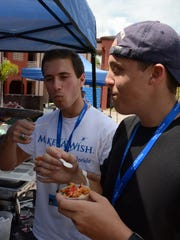 YLC president Matthew DeSantis, right, and vice president John Zizzo sample the offerings.