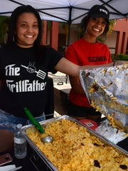 Elyssia Marrero, left, and Dakota Peoples of Beach Brothers BBQ offer their Flaming Mac.""