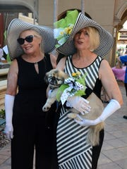 "Yolanda Medwid and Cathy Bressan coordinate with Brady. The Greater Marco Island Family YMCA brought ""Mutts & Martinis"" back to the Esplanade Wednesday evening, giving dog owners an excuse to dress up their pets while the humans consumed adult beverages."