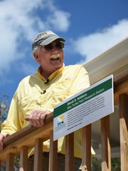 Conservancy biologist Dave Addison, who started the Conservancy's Sea Turtle Rescue and Monitoring program 35 years ago, stands beside a plaque naming the research station for him. The Conservancy of Southwest Florida cut the ribbon for its new turtle house on Keewaydin Island on Monday, April 10, 2017, with a mostly paid-for facility honoring the longtime head of loggerhead sea turtle research replacing the crumbling former building.