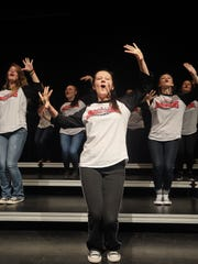 Courtney Neace, center, and other members of the Austin High School's Dimensions show choir prepare for a national competition.