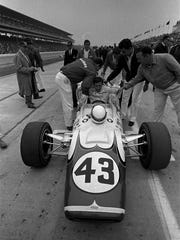 Jackie Stewart, 27, of Dunbarton, Scotland, is congratulated May 13, 1967, after qualifying for the Indianapolis 500 Mile Race.  Stewart, who was named  Rookie of the Year  after last year's race, qualified for the Memorial Day race with an average speed of 162.221 miles an hour.  (AP Photo/stf)