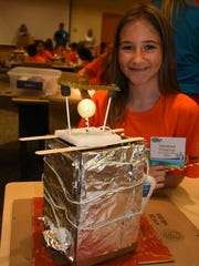 Fourth grader Penelope Freeman shows off her team's completed project. On Saturday, May 13, over 300 students from every public school in Collier County competed in the STEAM Conference at the FSW campus in East Naples.