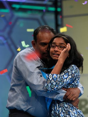 "June 1, 2017; National Harbor, MD, USA; Ananya Vinay is the 2017 Scripps National Bee Champion. The 12-year-old spelled ""marocain"" correctly to win during the championship  round of the 2017 Scripps National Spelling Bee at the Gaylord National Resort and Convention Center."