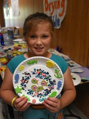 Devin Wood, 8, displays the project she made at Camp Mackle. Summer camps from the YMCA and the City of Marco have started up, giving parents choices for summer enrichment for their children.