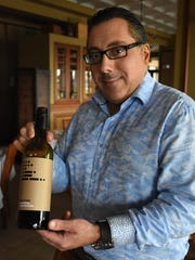 """Chop 239 owner Marco Porto with Morse Code shiraz, a wine that will be featured among the pairings. Wine and food pairings will tantalize the palate at """"The Glory of the Grape,"""" the Chamber of Commerce event hosted this year at Chop 239 on Sunday evening."""