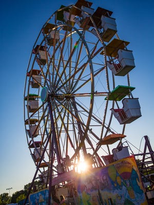The ferris wheel at sunset. Oshkosh Sawdust Days offered a variety of activities and entertainment Sunday, July 2, 2017  in Menomonee Park.