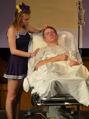"""Jake Carl (John Bohatch) with cheerleader Kathy (Kathlyn Smith) in """"Cost of Winning,"""" a play by Red Bluff resident Denise Derk."""