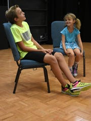 Tyler Mastrangelo plays theater games with Kate Anderson.