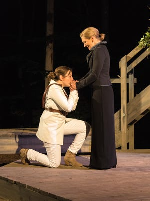 "Elyse Edelman (left) brings a message to Deborah Staples in Door Shakespeare's production of ""Twelfth Night."""