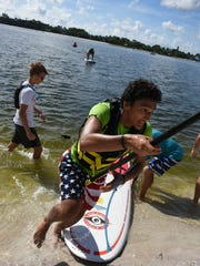Stefan Johnson stays focused as he finishes his winning race. Collier County hosted the Special Olympics Florida Area 9 Standup Paddle (SUP) Games on Saturday, July 15 at Sugden Regional Park in Naples.