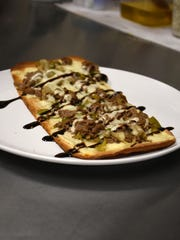 An order of flatbread with steak. Joey D's Italian