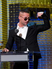 In a March 9, 2011 photo Mike The Situation Sorrentino appears onstage at the Comedy Central Roast of Donald Trump in New York.   Abercrombie & Fitch Co. says in a news release Tuesday Aug. 16, 2011 that they are concerned that having Sorrentino  seen in its clothing could cause significant damage to the company's image, and has offered a payment for him and other cast members of Jersey Shore to not wear the company's clothes on the show. (AP Photo/Charles Sykes)
