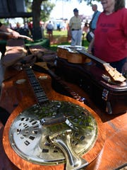 Bluegrass instruments cover a table back stage at the