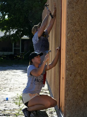First year law students at Ave Maria School of Law spent hours working to build houses at several Habitat for Humanity locations on Saturday, August 12, in a service project and team-building exercise.