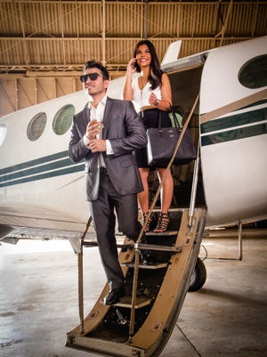 JD Iriarte, front, and Erani Zuniga, step off of a private jet on July 13, 2017, at the Katcha Air Hangar in Tiyan.