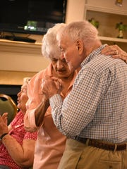 "Two residents in the assisted living facility sway to the memories as ""Velvet Touch"" performs."