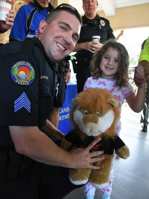Sgt. Mark Haueter of the MIPD interfaces with community member Bella Morrow during a community Coffee with a Cop event last year.