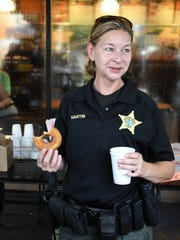 Sheriff's Corporal Tamy Martin is the only officer brave enough to consume a donut on camera. The Collier County Sheriff's Office partnered with the Marco Island Police Department and Dunkin Donuts Friday morning to offer the community Coffee with a Cop.