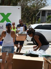 More supplies - FedEx delivers additional donations to 1994 Sheffield Ave. The Marco Patriots came together as local residents banded together to offer hurricane relief.