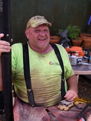 Art Schroth relaxes from sawing downed trees. Two groups of disaster relief volunteers coordinated by the Wesley United Methodist Church on Marco drove down from Tennessee to help residents after Hurricane Irma.
