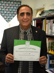 Principal George Abounader with the certificate or