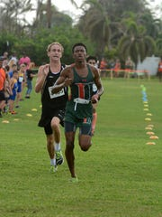 Top finishers Dylan Reichenbacher, left, and Ralph Claude battle for the lead, finishing within a tenth of a second of each other. Marco Island Academy hosted 768 runners from 32 schools on Saturday morning at Mackle Park in the MIA Rays Invitational cross country meet.
