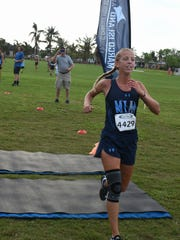 MIA senior Olivia Watt cruises to victory in the varsity 5K. Marco Island Academy hosted 768 runners from 32 schools on Saturday morning at Mackle Park in the MIA Rays Invitational cross country meet.