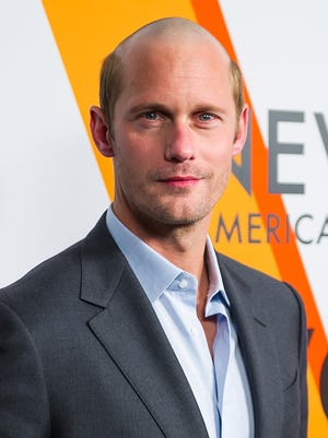 Alexander Skarsgard debuted his new 'do on the red carpet for the Volez, Voguez, Voyagez - Louis Vuitton Exhibition opening.