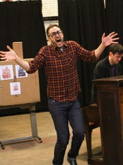 """Joe Kinosian (left) rehearses a scene from """"Murder"""