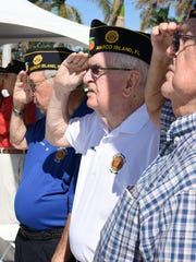 Veteran Jim Curran salutes the flag on Nov. 11, 2017. Marco Island commemorated Veterans Day Saturday at Veterans' Community Park, with speeches, flags and patriotic music.